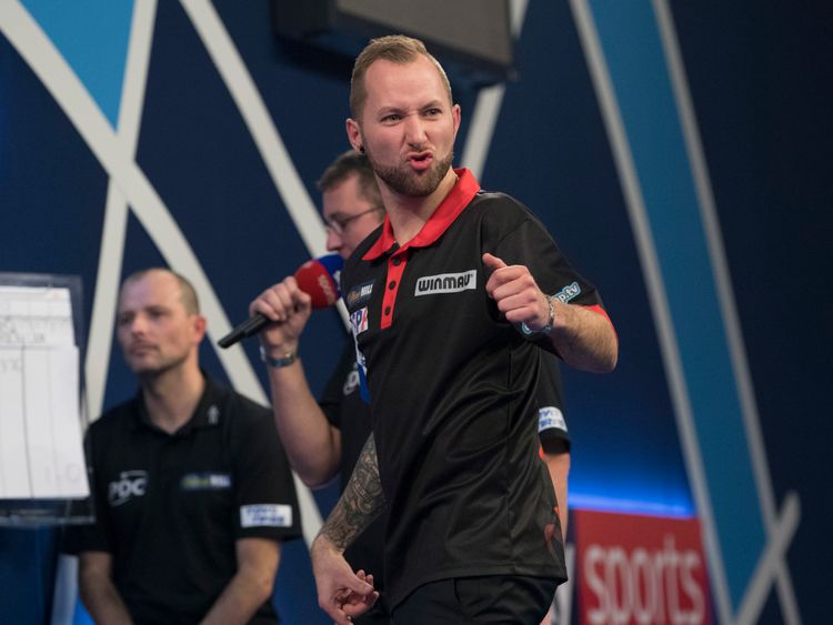 Danny Noppert of the Netherlands in action against Royden Lam of Hong Kong during Day Two of the 2019 William Hill World Darts Championship at Alexandra Palace on December 14, 2018 in London, United Kingdom.