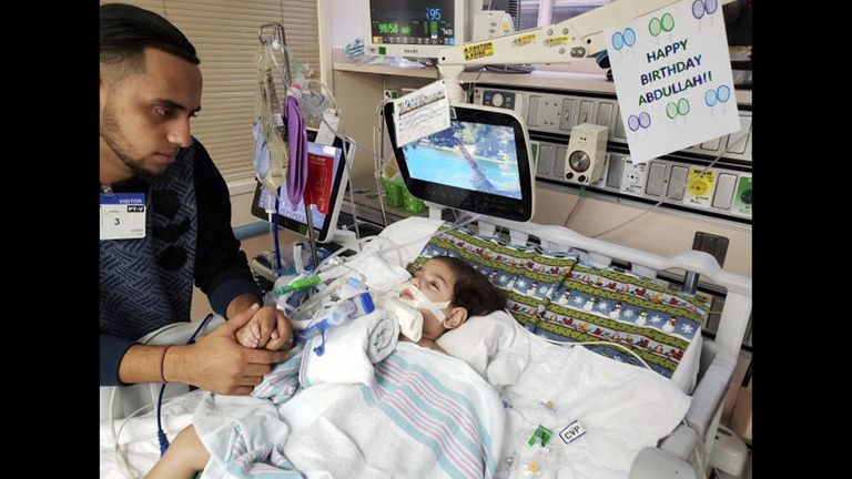 Ali Hassan with his dying son Abdullah, 2, in a hospital in Sacramento. Pic: Council on American-Islamic Relations