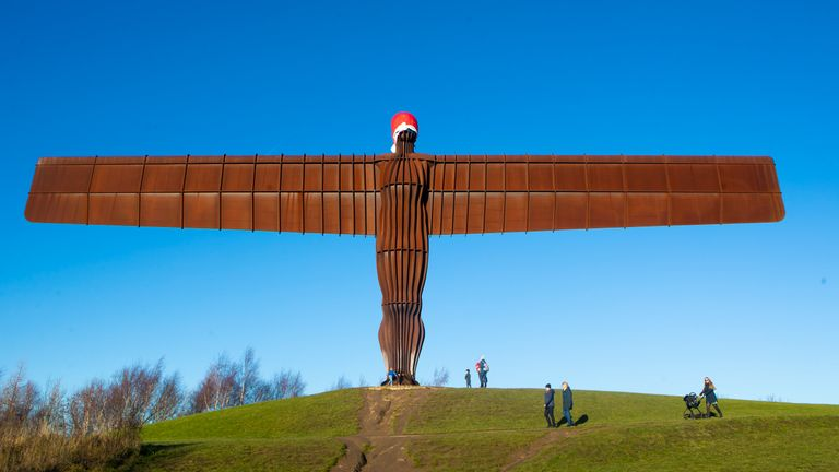 A Santa hat on the 20 metres tall steel sculpture 'Angel of the North', outside Gateshead, Tyne and Wear