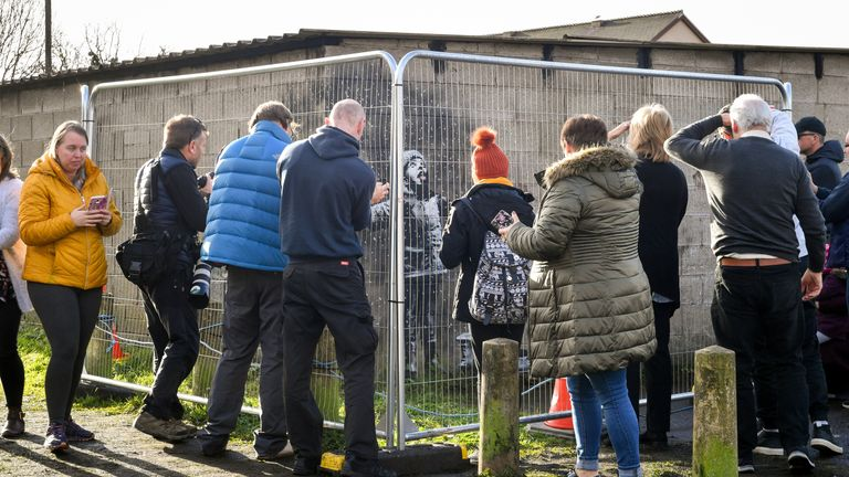Crowds have been flocking to see the Banksy mural