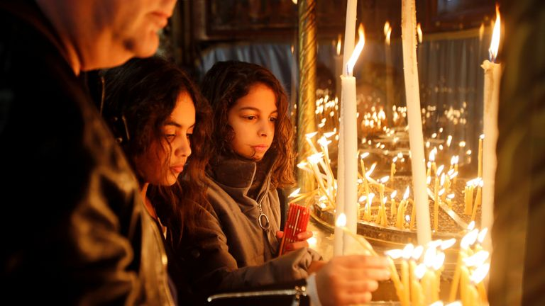 Girls light candles at the Church of the Nativity, in Bethlehem in the Israeli-occupied West Bank December 23, 2018
