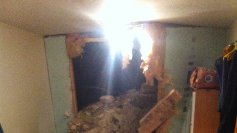 A bedroom after a giant boulder fell and smashed through the wall of a home in White Rock, Hastings