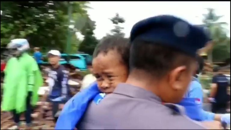 Boy rescued from rubble after tsunami in Indonesia