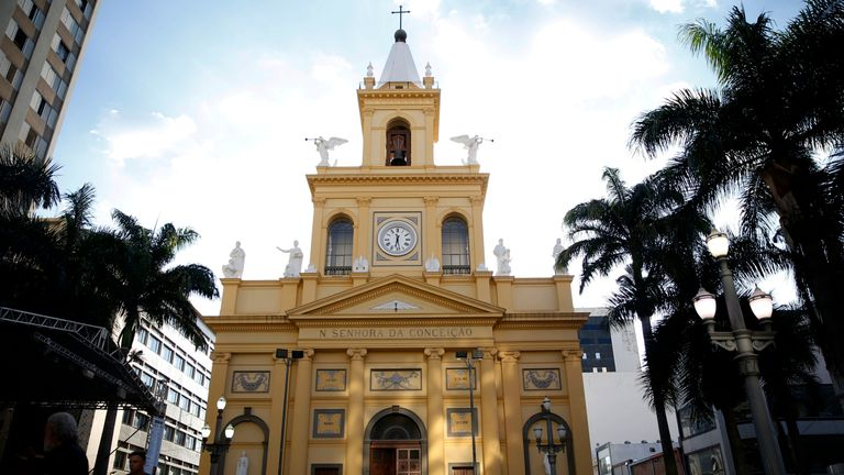 Four people were killed after a man opened fire in a cathedral in southern Brazil