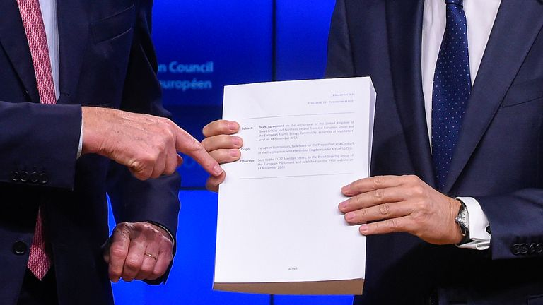 EU negotiator Michel Barnier hands EC president Donald Tusk the draft deal text