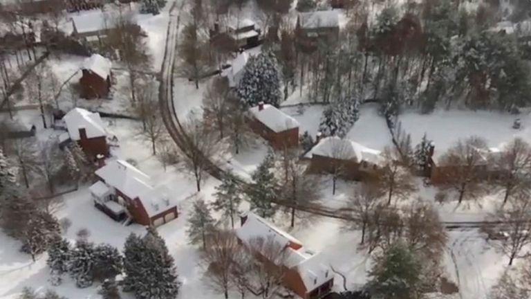 An aerial view shows snow in Cave Spring, Virginia, U.S., December 10, 2018, in this still image taken from a social media video. Pic: Mark Patterson