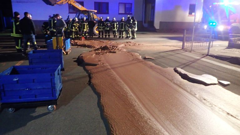Spilt chocolate is cleared from a road in Werl, Germany