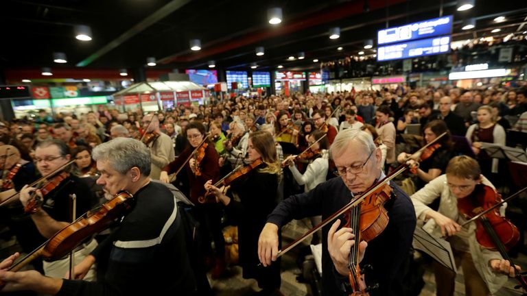 People sing and play instruments during the performance of 'Czech Christmas Mass' by the Czech composer Jakub Jan Ryba at Prague's main railway station, Czech Republic, December 23, 2018