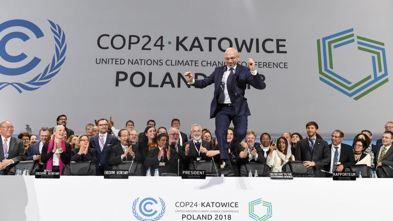 COP24 president Michal Kurtyka celebrates at the end of the final session of the COP24 summit