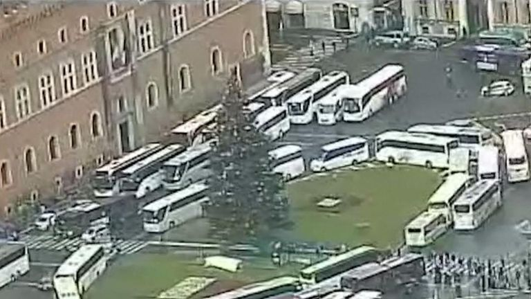 Coaches block city centre roads in Rome in protest at being banned from next year