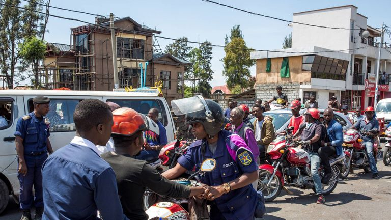 A police officer directs traffic near the university in Goma amid protests