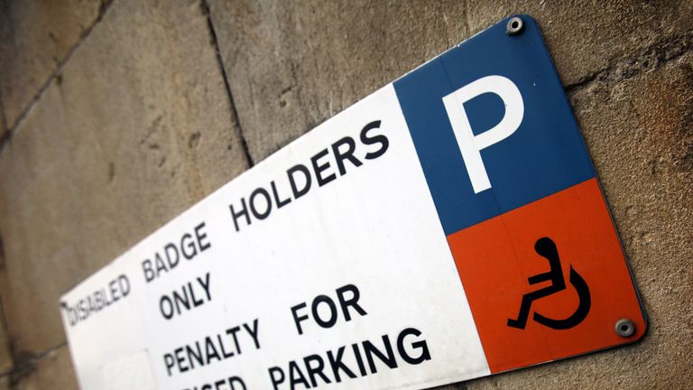 BATH, ENGLAND - FEBRUARY 16: A sign is displayed above a disabled car parking bay on February 16, 2011 in Bath, England. The government is currently considering a range of measures after it was revealed that the system - which allows badge holders free parking in many pay-and-display bays, at meters and on single- and double-yellow lines - was being widely abused. Currently, over 2.5million people qualify for the scheme, but research has shown that over a half of users are not entitled to use th