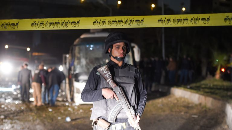 A member of the Egyptian security forces stands guard at the scene of an attack on a tourist bus in Giza
