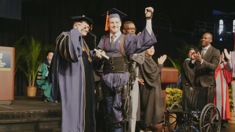 A college student who was paralysed after suffering a spinal injury was able to walk during his graduation ceremony.