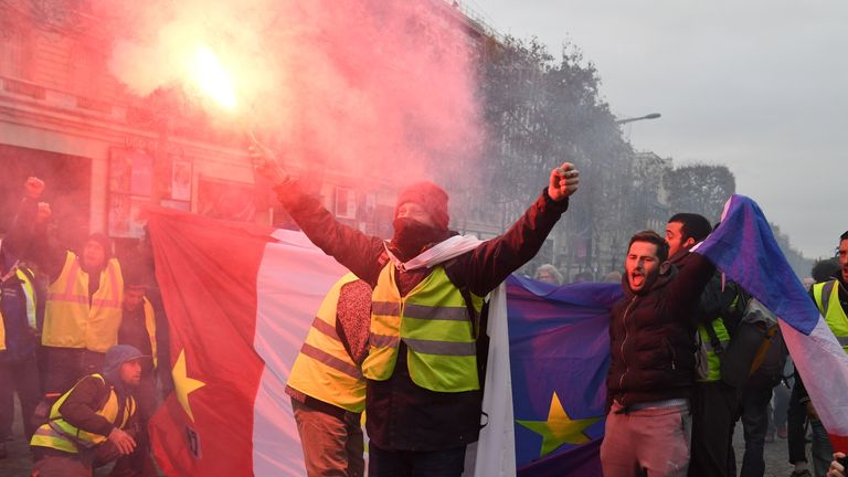 PARIS, FRANCE - DECEMBER 08: People take part in the demonstration of the yellow vests near Champs-Elysees avenue on December 08, 2018 in Paris France. 'Yellow Vests' ('Gilet Jaunes' or 'Vestes Jaunes') is a protest movement without political affiliation that protests against taxes and rising fuel prices. The 'Yellow Vest' protests have wrecked parts of Paris and other French cities for nearly a month, as the movement - inspired by opposition to a new fuel tax - has absorbed a wide range of anti