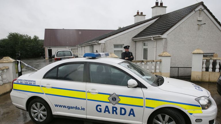 Gardai outside a house in Castletown, Kilpatrick, near Navan, Co Meath, which has been sealed off as six people have been arrested after a man alleged he was being falsely imprisoned at the property.