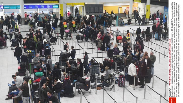 Passengers wait at Gatwick airport