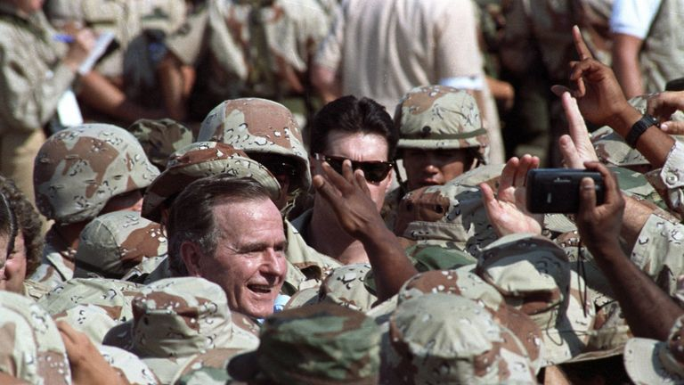 George HW Bush meets US troops during the Gulf War
