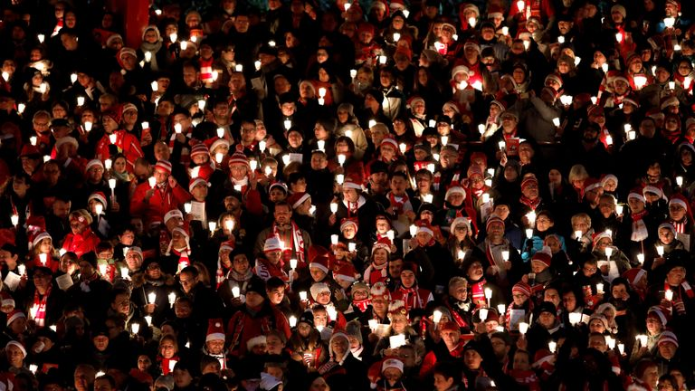 Fans of the FC Union football club gather in the club's stadium to sing Christmas carols on December 23, 2018 in Berlin, Germany