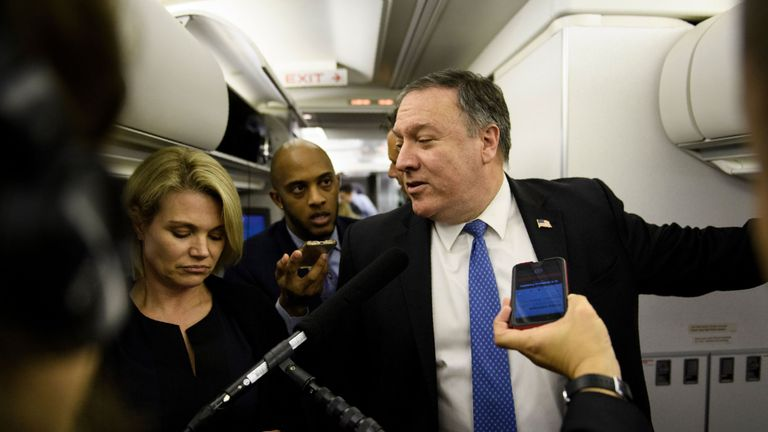 Spokesperson Heather Nauert (L) listens while US Secretary of State Mike Pompeo speaks with reporters