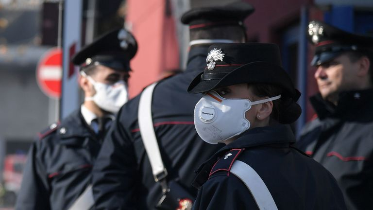 Police wore masks after a fire broke out overnight at the TMB Salario mechanical biological waste treatment plant
