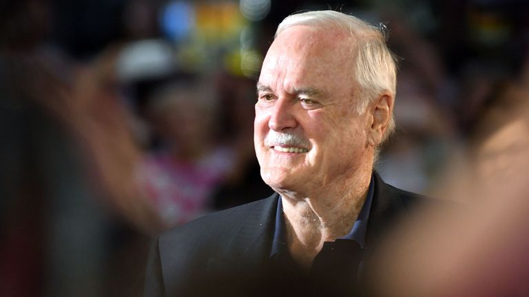 John Cleese did not want to stay in England in the winter