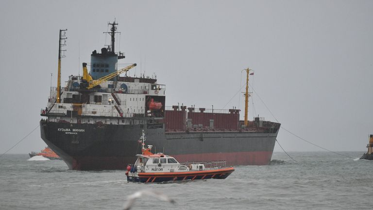 A pilot boat passes the vessel after it got stuck on Tuesday