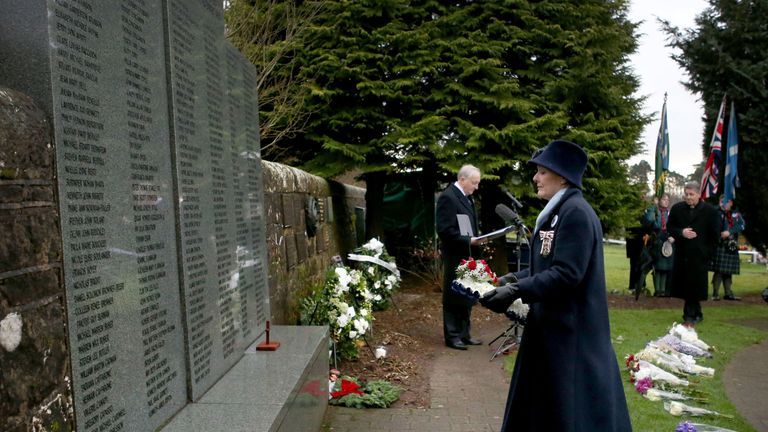 Carisa Harris-Adamson, from San Francisco lays a wreath in memory of her uncle John Cummock