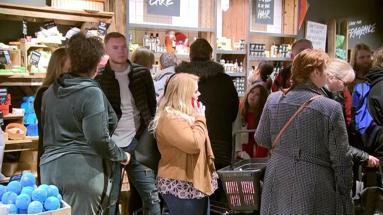 Boxing Day bargain hunters queue outside a Lush store