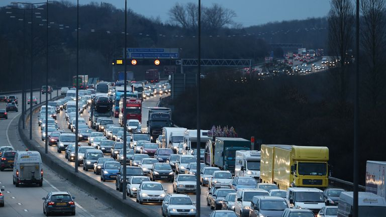 Traffic lines up on the M-25 motorway south of London on March 28, 2013 near Leatherhead, England. Up to one million Britons are expected to leave for warmer weather abroad after a long than usual spell of below average temperatures.