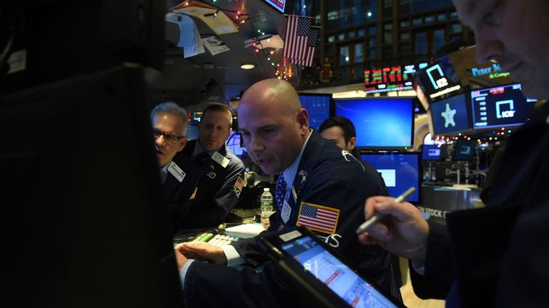 Traders work on the floor of the New York Stock Exchange (NYSE) in New York, U.S., December 21, 2018