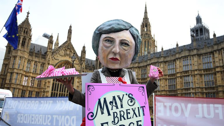 A demonstrator dressed as Theresa May outside the Houses of Parliament