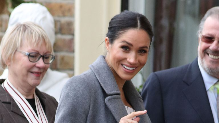 Meghan was all smiles as she arrived at Brinsworth House
