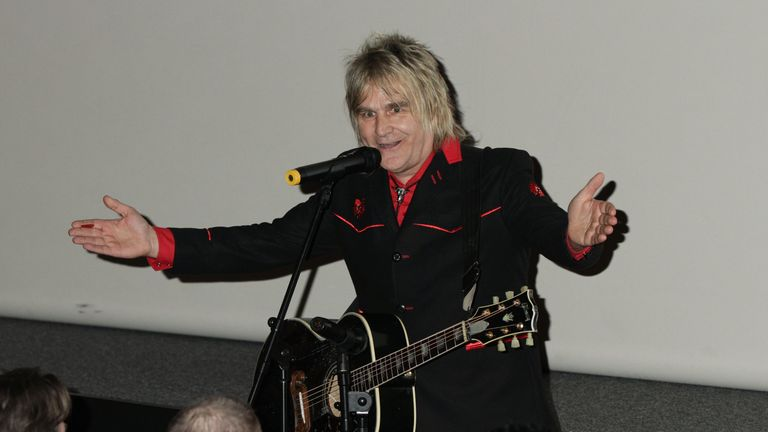 Mike Peters of The Alarm performing a song before the gala screening of Vinyl, at the Empire Leicester Square in central London. PRESS ASSOCIATION Photo. Picture date: Tuesday March 12, 2013. Photo credit should read: Yui Mok/PA Wire