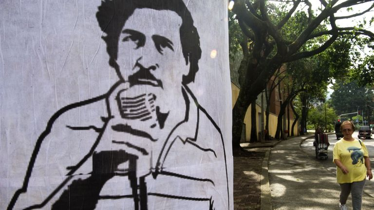 A poster with the image of Pablo Escobar hangs on a street in Medellin, Colombia