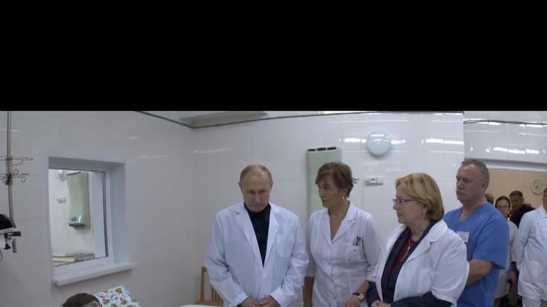 Vladimir Putin visits the site of a gas explosion in the southern Russian city of Magnitogorsk