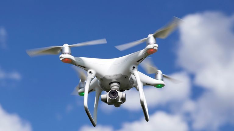 A quadcopter drone can cost several hundred pounds and is fitted with a camera for filming and taking photographs