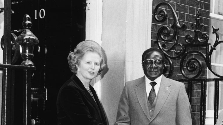 Margaret Thatcher shaking hands with Robert Mugabe outside 10 Downing Street in 1980
