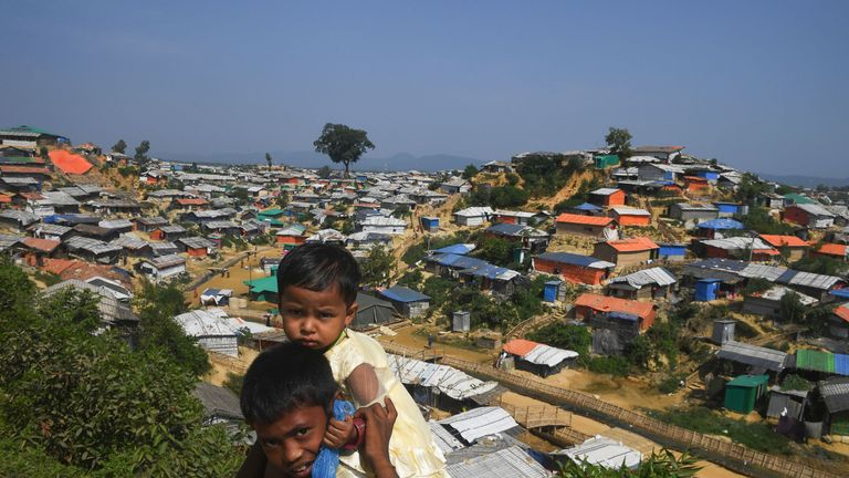 Young Rohingya refugees look on as a general view of Balukhali refugee camp is pictured in Ukhia