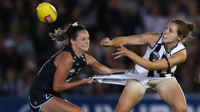 Nicola Stevens of the Blues tackles Jasmine Garner of the Magpies during the round one AFLW match between the Carlton Blues and the Collingwood Magpies at Ikon Park on February 2