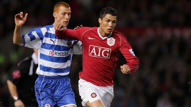 Steve Sidwell batlles with Cristiano Ronaldo in an FA Cup tie