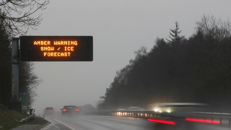 Cars travel past a weather warning sign on the A9 road near Stirling, in Scotland December 15, 2018