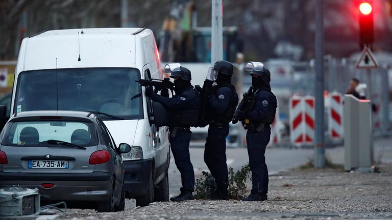 French special police forces secure an area during an operation in the Meinau district after the deadly shooting in Strasbourg