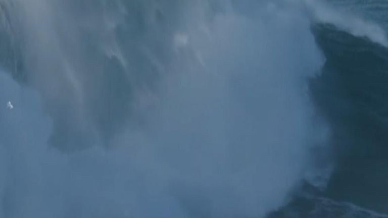 British man Tom Butler claims this wave, being surfed by him, was over a hundred feet tall