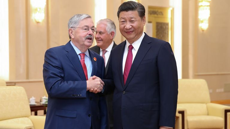 US ambassador Terry Edward Branstad (L) shakes hands with Chinese President Xi Jinping (R)