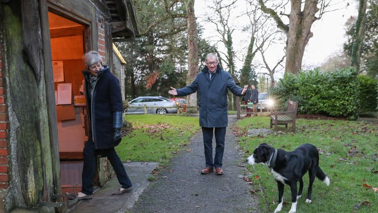 Theresa and Philip May were greeted by border collie Blitz outside their church near Maidenhead on Sunday