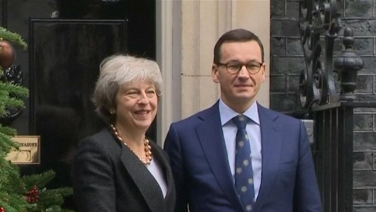 Theresa May greets Polish prime minister, but ignores questions about potential second Brexit referendum