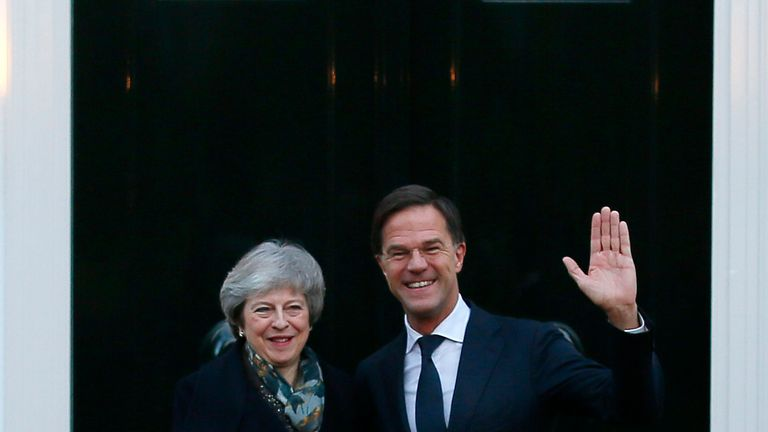 Theresa May is greeted by Dutch Prime Minister Mark Rutte