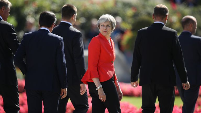 Theresa May looks back as she and other leaders depart following the family photo on the second day of an informal summit of leaders of the European Union