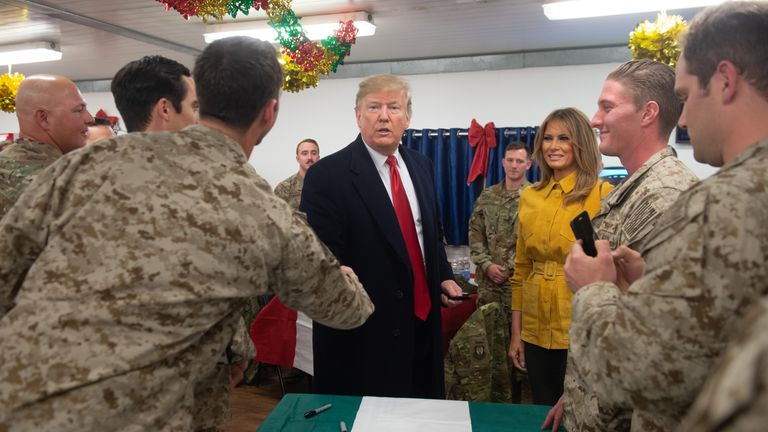 Donald and Melania Trump greet members of the US military during a surprise visit to the Al Asad Air Base in Iraq